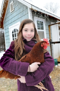 Ten year-old Ella Stier poses with Lila, a favorite Rhode Island Red.